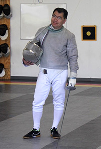 Man in fencing uniform and foil